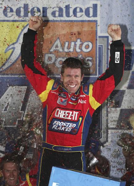 Carl Edwards celebrates winning the NASCAR Sprint Cup Series auto race at Richmond International Raceway in Richmond, Va., Saturday, Sept. 7, 2013. (AP Photo/Zach Gibson)