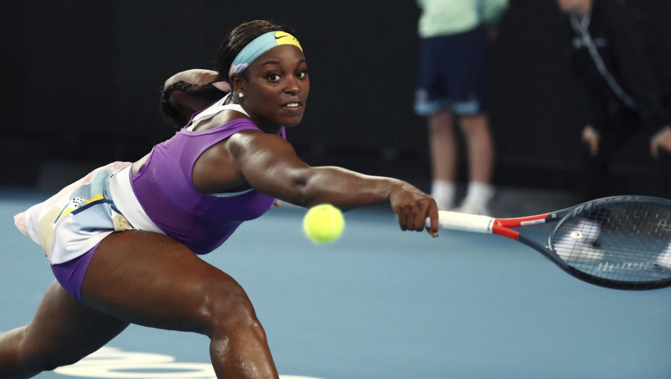 United States' Sloane Stephens makes a backhand return to China's Zhang Shuai during their first round singles match at the Australian Open tennis championship in Melbourne, Australia, Monday, Jan. 20, 2020. (AP Photo/Dita Alangkara)