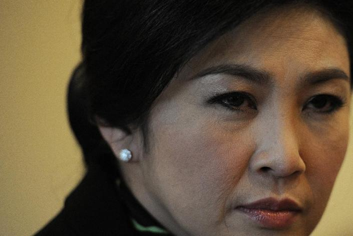 Yingluck Shinawatra has defended the controversial rice subsidy scheme for improving the living standards of thousands of farmers (AFP Photo/Christophe Archambault)