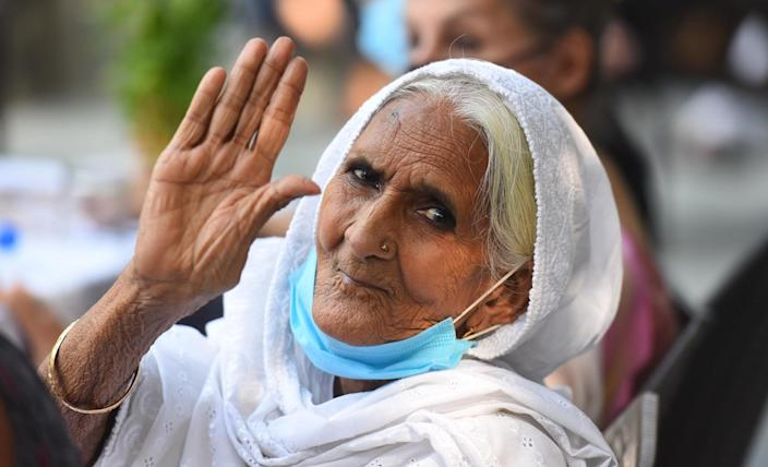 NEW DELHI, INDIA - SEPTEMBER 29: Bilkis Dadi waves for a photograph during a felicitation ceremony at Press club on September 29, 2020 in New Delhi, India. (Photo by Raj K Raj/Hindustan Times via Getty Images)