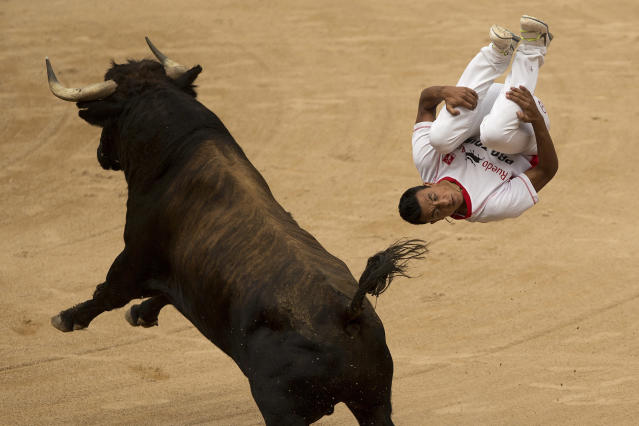 """<p>A recortador, or """"bull-leaper,"""" competes at the San Fermín festival in Pamplona, Spain, July 11, 2015. (AP Photo/Andres Kudacki) </p>"""