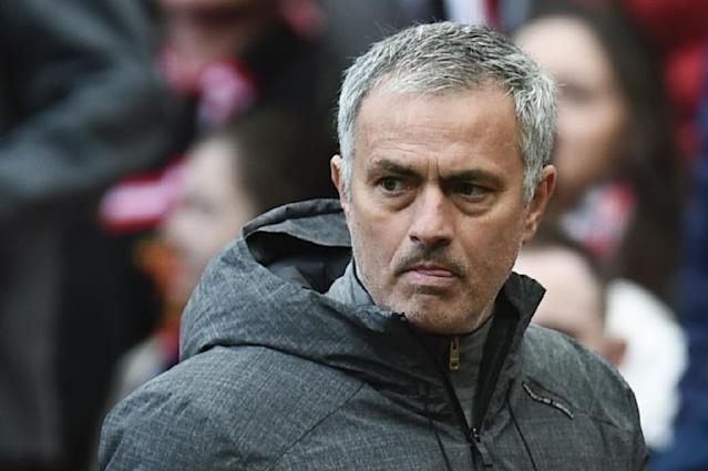 """""""When it's mathematically very possible to finish in the (Premier League) top four, if we play against Chelsea with the second team, you would kill me and the football country would kill me,"""" Manchester United manager Jose Mourinho told reporters (AFP Photo/Oli SCARFF )"""