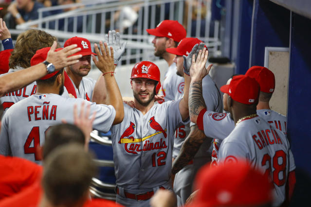 St. Louis Cardinals' Paul DeJong (12) is congratulated by teammates after his two-run home run during the fourth inning of a baseball game against the Atlanta Braves, Tuesday, Sept. 18, 2018, in Atlanta. (AP Photo/Todd Kirkland)