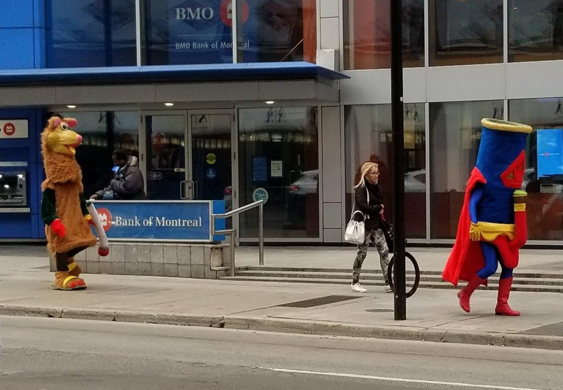 <p>Just a giant bong and rat (?) with a joint walking down Yonge Street. Another day in Toronto. #legalizationday<br />Twitter @chris_teeter </p>