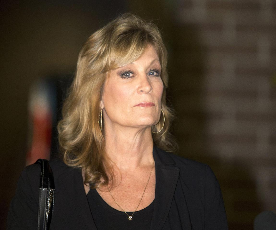 In this Dec. 5, 2014 file photo, Judy Huth appears at a press conference outside the Los Angeles Police Department's Wilshire Division station in Los Angeles about her lawsuit against Bill Cosby alleging he abused her at the Playboy Mansion around 1974 when she was 15-years-old. Cosby is spending millions of dollars on teams of high-priced lawyers across the country amid a cascade of sexual assault allegations, defamation claims and insurance disputes. (AP Photo/Anthony McCartney, File)