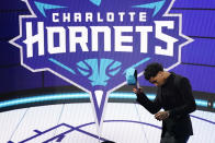 James Bouknight steps off the stage after being selected 11th overall by the Charlotte Hornets during the NBA basketball draft, Thursday, July 29, 2021, in New York. (AP Photo/Corey Sipkin)