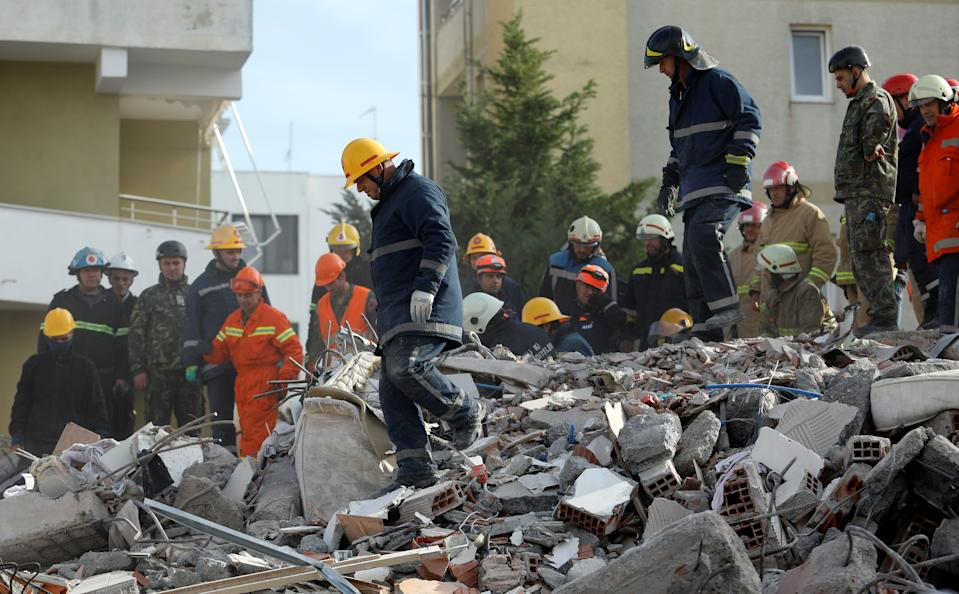 Emergency personnel work at the site of a collapsed building in the town of Durres, following Tuesday's powerful earthquake that shook Albania, November 27, 2019. REUTERS/Florion Goga