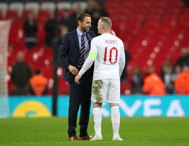 England manager Gareth Southgate shakes hands with Rooney (Nick Potts/PA)