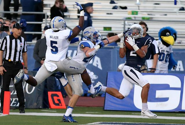 Nevada's Richy Turner (2) catches a touchdown pass against the Air Force defense during the first half of an NCAA college football game in Reno, Nev., on Saturday, Sept. 28, 2013. (AP Photo/Cathleen Allison)