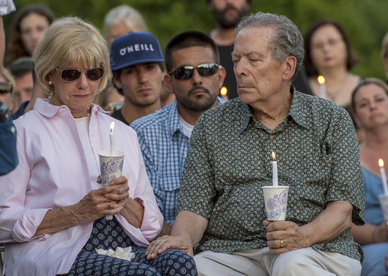 Sharon and Rich Patrick, grandparents and legal guardians of Jimi Tar Patrick, who was one of four men killed, participate in a prayer and candlelight vigil for the four men at the Garden of Reflection in Lower Makefield, Pa., Sunday, July 16, 2017. Police found the four missing men's remains on a farm in Solebury Township, Pa., last week. The farm owners' son and his cousin have been charged in the slayings. (Clem Murray/The Philadelphia Inquirer via AP)