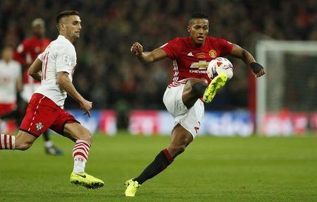 Manchester United's Antonio Valencia in action with Southampton's Dusan Tadic