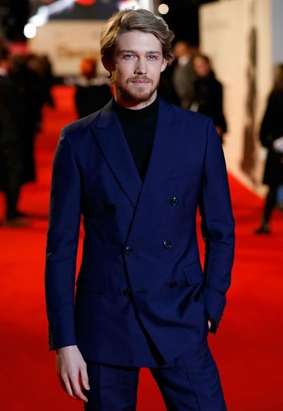 The British actor was also sporting some scruffy new facial hair on the red carpet.
