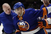 New York Islanders' Jordan Eberle (7) is helped off the ice after he was injured during the second period of an NHL hockey game against the New York Rangers Thursday, Jan. 16, 2020, in Uniondale, N.Y. (AP Photo/Frank Franklin II)