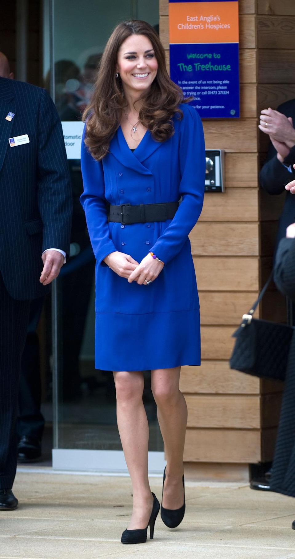 <p>The Duchess opened a children's hospice in a royal blue dress from Reiss paired with a thick black belt and heels by Episode.</p><p><i>[Photo: PA]</i></p>
