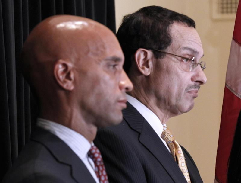 FILE - In this Oct. 13, 2010 file photo, then-DC City Council chairman and Democratic Mayoral candidate Vincent Gray, right, and then-Washington Mayor Adrian Fenty participate in a Washington news conference. Halfway through what has so far been a scandal-stained first term as Washington's mayor, Vincent Gray can't seem to escape the shadow of the predecessor he defeated by a hefty margin two years ago. Gray's performance in office has been steady but not splashy. And his winning campaign is the subject of a federal investigation that leaves his political future uncertain. So far, three former aides have pleaded guilty to felonies.  (AP Photo/Pablo Martinez Monsivais, File)