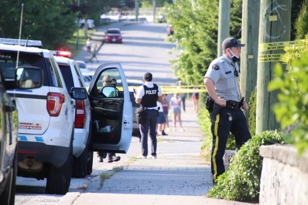 Police on the scene of an incident that paramedics describe as a potential shooting on Hart Street in Coquitlam on Saturday May 22, 2021. (Shane MacKichan - image credit)