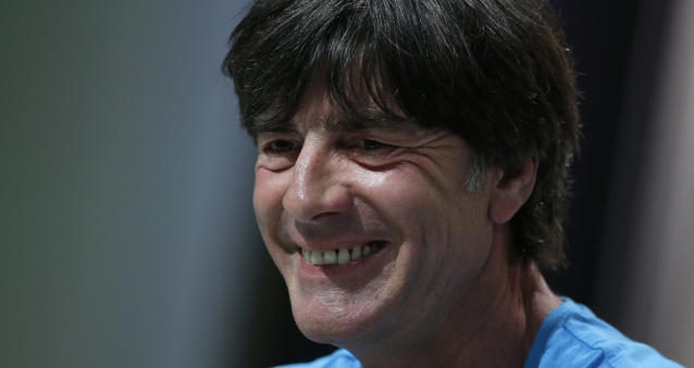 German national soccer team head coach Joachim Loew laughs during a news conference in Santo Andre near Porto Seguro, Brazil, Thursday, June 12, 2014. Germany will play in group G of the 2014 soccer World Cup. (AP Photo/Matthias Schrader)