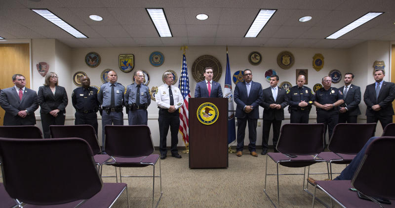 G. Zachary Terwilliger, U.S. Attorney, center, speaks during a press conference inside the United States Attorney's Office in Norfolk, Va., Thursday, Aug. 29, 2019. Law enforcement officials in Virginia say they've busted a multi-state drug ring and seized enough cheap fentanyl to kill 14 million people. The bust was announced Thursday in Norfolk by Terwilliger, the U.S. Attorney for the Eastern District of Virginia. (L. Todd Spencer/The Virginian-Pilot via AP)
