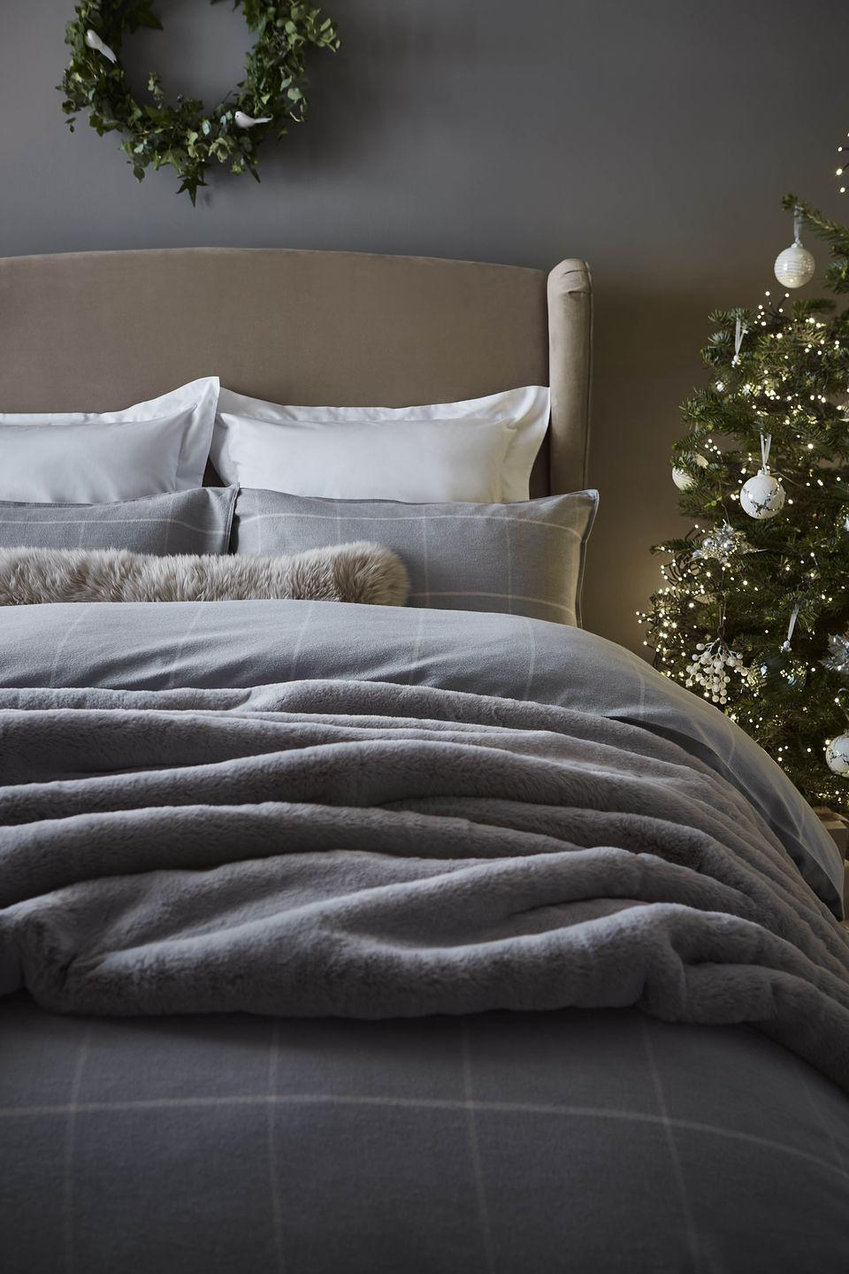 """<p>Short days and long nights mean more time at home, which is a great opportunity to ramp up the cosy volume in your bedroom. As part of Dunelm's Christmas range, you'll find fluffy throws, festive bedding and cushions to curl up with. </p><p><strong>READ MORE</strong>: <a href=""""https://www.housebeautiful.com/uk/lifestyle/g23481079/christmas-bedding/"""" rel=""""nofollow noopener"""" target=""""_blank"""" data-ylk=""""slk:26 Christmas bedding sets every bedroom needs this festive season"""" class=""""link rapid-noclick-resp"""">26 Christmas bedding sets every bedroom needs this festive season</a></p>"""