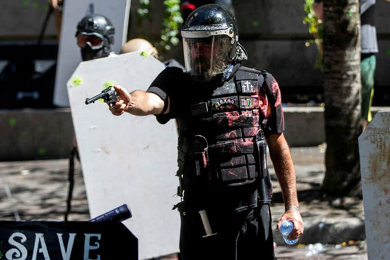 FILE PHOTO: FILE PHOTO: Protesters clash with police in Portland