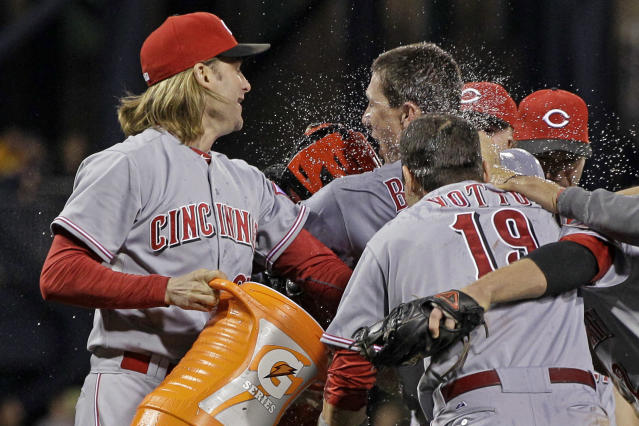 Cincinnati Reds pitcher Homer Bailey, right rear, celebrates with teammates Bronson Arroyo, left, and Joey Votto (19) after pitching a no-hitter in a baseball game against the Pittsburgh Pirates in Pittsburgh Friday, Sept. 28, 2012. The Reds won 1-0. (AP Photo/Gene J. Puskar)