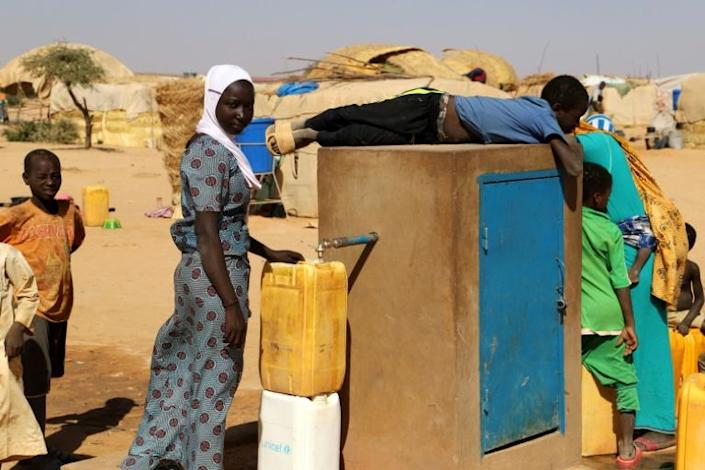 Children who survived the attack in Tchoma Bangou fetch water at a displaced camp in Ouallam