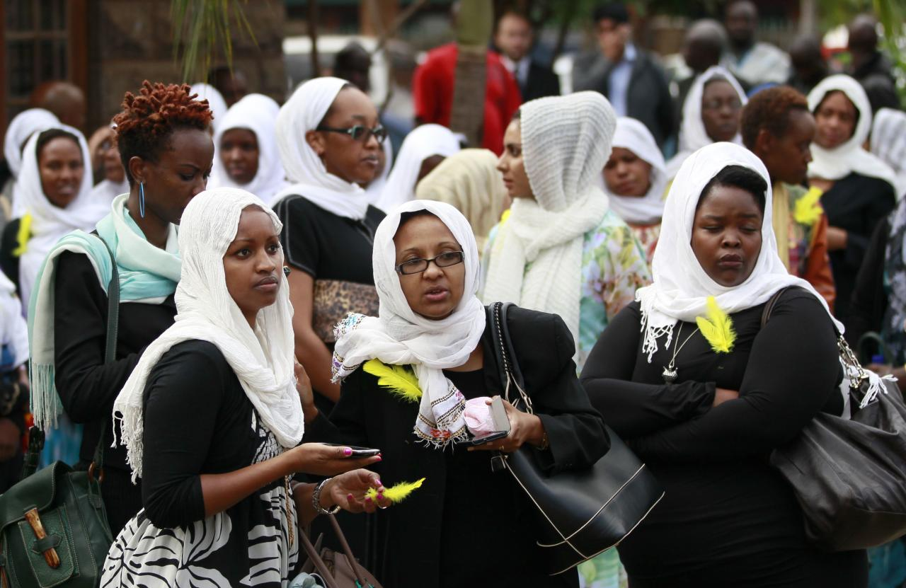 Kenyan journalists gather for the funeral prayers of their colleague Ruhila Adatia Sood, who was killed in the Westgate shopping mall attack, in Kenya's capital Nairobi September 26, 2013. U.S., British and Israeli agencies are helping Kenya investigate the attack claimed by Somali Islamist militants on the Nairobi shopping mall that killed at least 72 people and destroyed part of the complex, officials said on Wednesday. REUTERS/Thomas Mukoya (KENYA - Tags: CIVIL UNREST CRIME LAW RELIGION)
