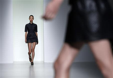 A model presents a creation from the J. JS Lee Spring/Summer 2014 collection during London Fashion Week September 13, 2013. REUTERS/Olivia Harris