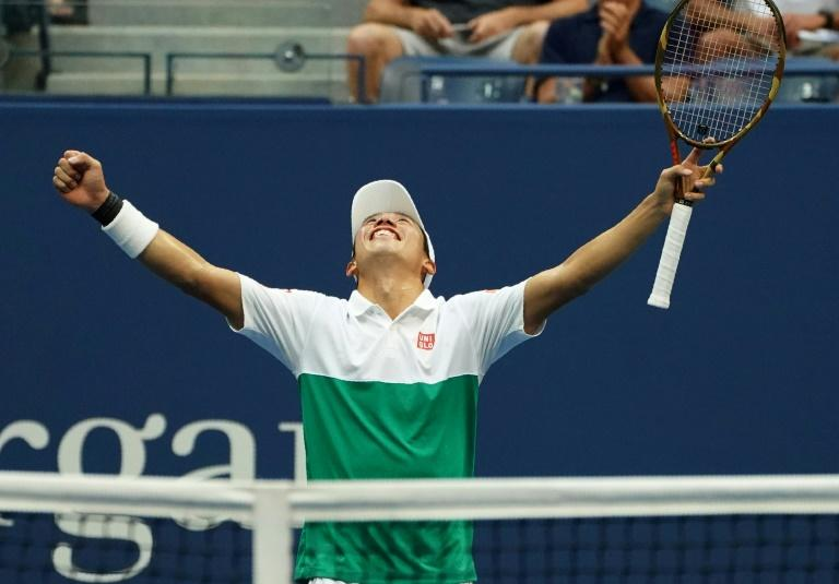 At last: Kei Nishikori celebrates his five-set victory over Marin Cilic in the quarter-finals of the US Open