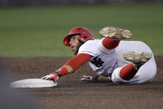 Louisiana Lafayette's Ryan Leonards reacts as he is caught stealing second base in the first inning of an NCAA college baseball tournament super regional game against Mississippi in Lafayette, La.,Sunday, June 8, 2014. (AP Photo/Gerald Herbert)