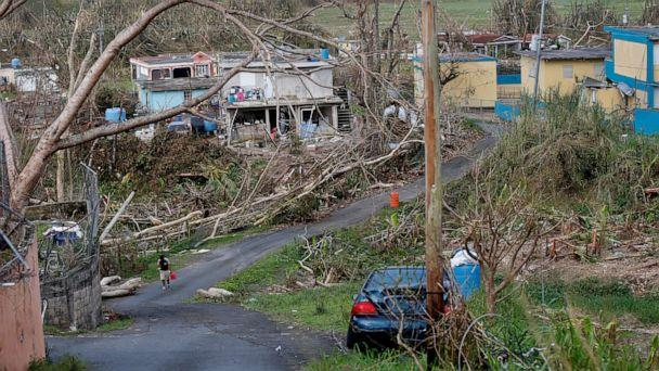 PHOTO: In this Sept. 26, 2017 file photo, Jonathan Aponte walks with a gas can up the road to his home in the aftermath of Hurricane Maria, in Yabucoa, Puerto Rico, Tuesday, Sept. 26, 2017. (Gerald Herbert/AP, File)