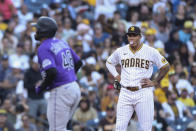 San Diego Padres third baseman Manny Machado, right, blows a bubble while Colorado Rockies' German Marquez runs the bases after hitting a home run during the fifth inning of a baseball game Saturday, July 31, 2021, in San Diego. (AP Photo/Derrick Tuskan)