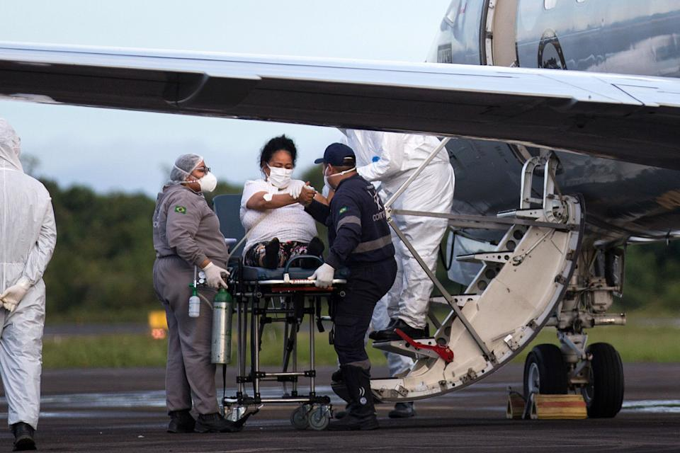 "<p>A Covid-19 patient is transferred in a military airplane to a different hospital as health services in Manaus, Brazil, are overwhelmed by cases linked to the new strain of coronavirus. A Government expert today said the variant is now ""likely"" in the UK</p> (AFP via Getty Images)"