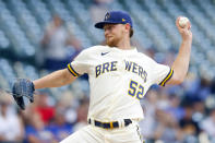 Milwaukee Brewers starting pitcher Eric Lauer throws to the Pittsburgh Pirates during the first inning of a baseball game Monday, Aug. 2, 2021, in Milwaukee. (AP Photo/Jeffrey Phelps)