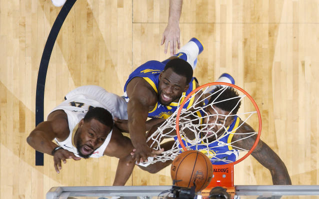 New Orleans Pelicans guard Tony Allen (24) goes to the basket against Golden State Warriors forward Jordan Bell,right, and forward Draymond Green, center in the first half of an NBA basketball game in New Orleans, Monday, Dec. 4, 2017. (AP Photo/Gerald Herbert)