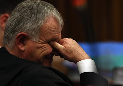 Defense lawyer for Oscar Pistorius, Barry Roux, reacts as he listens to evidence in court. (AP)