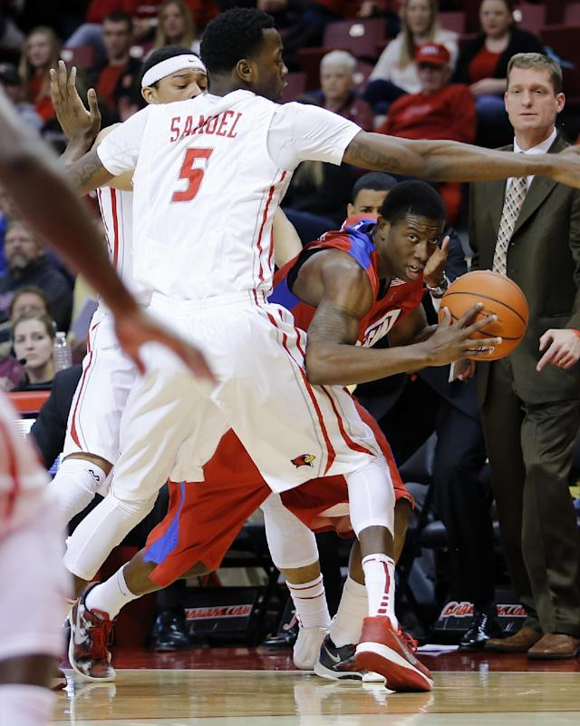Dayton guard Jordan Sibert (24) looks for room to pass under pressure from Illinois State forward Jamaal Samuel (5) and guard Zach Lofton (23) during the first half of an NCAA college basketball game at Redbird Arena Saturday, Dec. 7, 2013, in Normal, Ill. (AP Photo/ Stephen Haas)