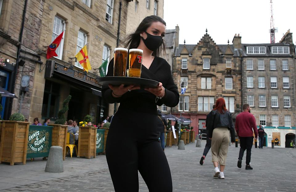 Pubs could once again sell alcohol indoors as well as out of doors if Scotland moves to Level 2 restrictions. (Andrew Milligan/PA)