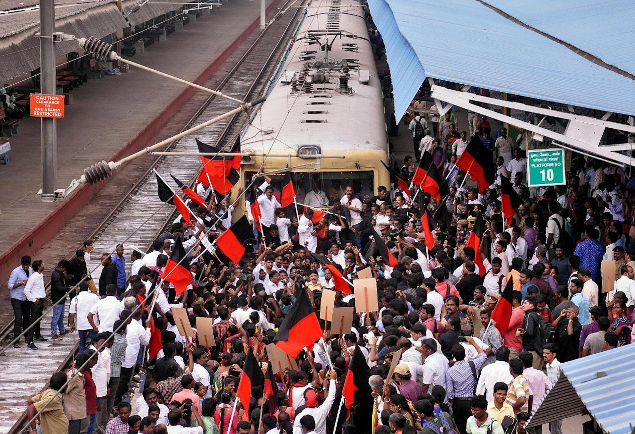 """Demonstrators hold a """"Rail Roko"""" protest, an attempt to disrupt the local train mobility as they demand a reverse of the Supreme Court ban on the traditional bull-taming contest, known as Jallikattu, at the Chennai Egmore railway station in Chennai, India, January 20, 2017. REUTERS/Stringer          FOR EDITORIAL USE ONLY. NO RESALES. NO ARCHIVES."""