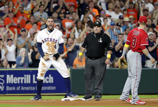Houston Astros' George Springer (4) yells after reaching third base on an RBI single by Carlos Correa as umpire Eric Cooper and Los Angeles Angels third baseman Taylor Ward (3) look on during the eighth inning of a baseball game, Saturday, Sep. 1, 2018, in Houston. (AP Photo/Michael Wyke)