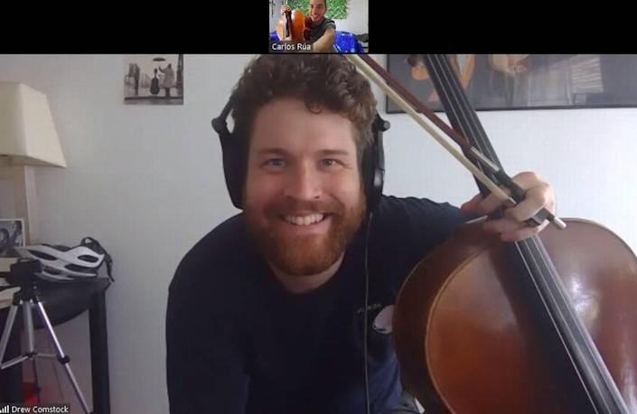 A screen grab of a virtual session shows New World Symphony fellow Drew Comstock coaching cello student Carlos Rua of the Iberacademy in Medellin, Columbia. The Miami Beach-based symphony has been operating fully online since the COVID-19 pandemic forced closure of Miami-Dade's cultural institutions.