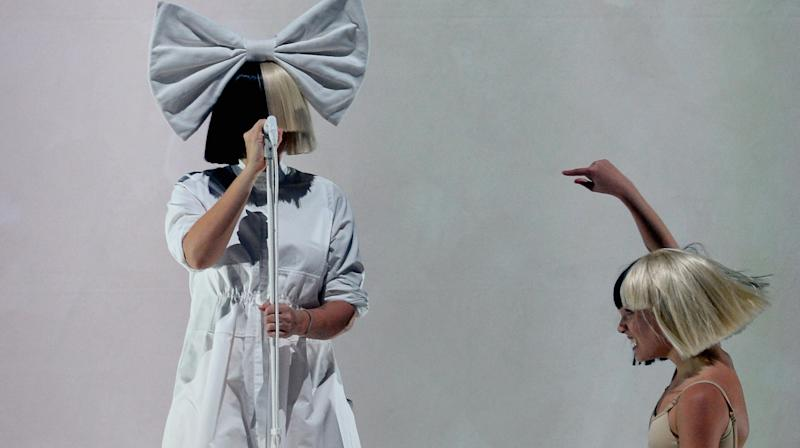 """Sia has responded to a suggestion that her choice to shun the limelight while making her teenage protegee, Maddie Ziegler, the star of her visuals, could be """"damaging"""" for the young star."""