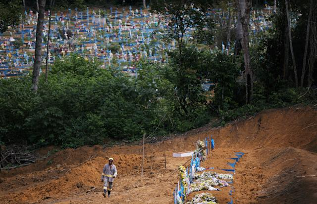A gravedigger walks at the Parque Taruma cemetery, amid the coronavirus disease (COVID-19) outbreak, in Manaus, Brazil June 17, 2020. REUTERS/Bruno Kelly TPX IMAGES OF THE DAY