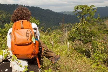 Enzo Monfre sitting above the Rios Tropicales Reforestation Project - Costa Rica - photo: Heidi Acott