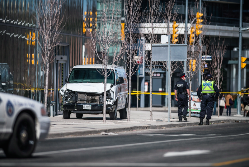 The van mounted a busy pavement in Toronto on Monday (Picture: Rex)