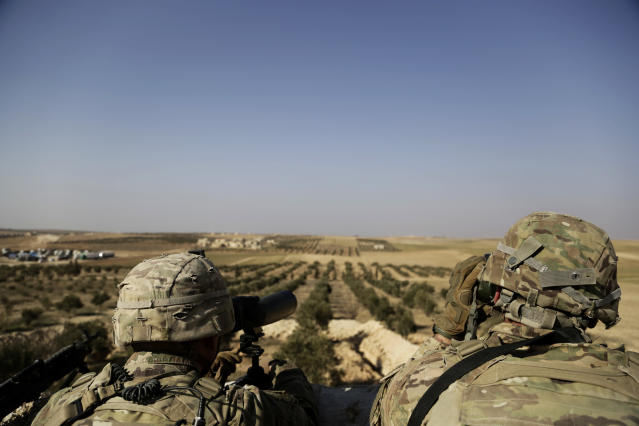 American troops look out toward the border with Turkey from a small outpost near the town of Manbij, in northern Syria. (Photo: Susannah George/AP)