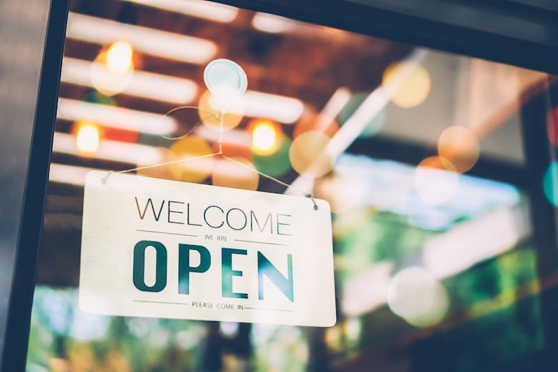 Welcome/Open sign in window of a shop.