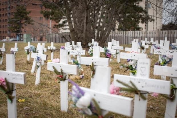 Crosses representing residents who have died of COVID-19 are pictured on the lawn of a long-term care home in Mississauga.