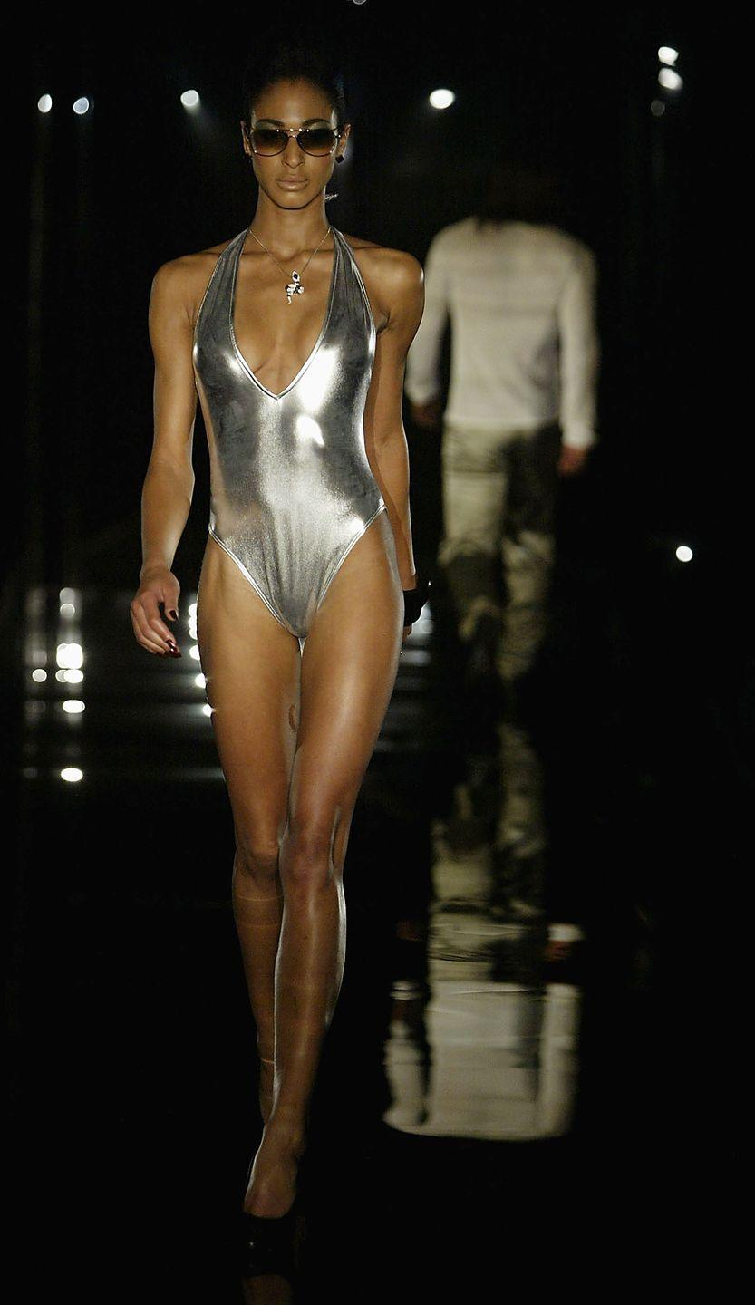 <p>Metallic lamé one-pieces and bikinis were huge in 2003, as this runway model proves.</p>