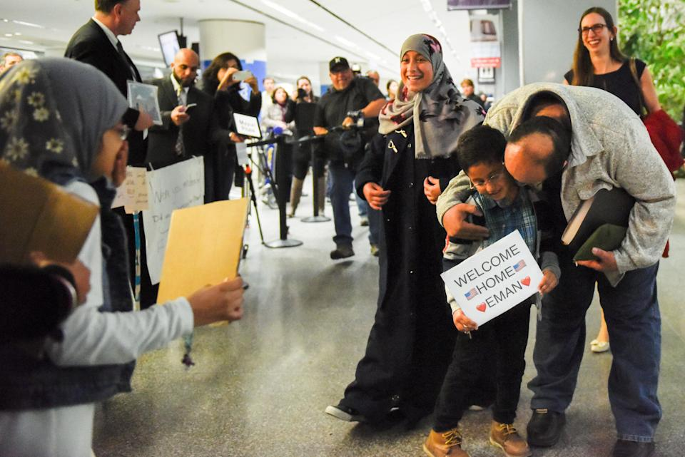 Eman Ali, 12, of Yemen,center, and her father, Ahmed Ali, arrive at San Francisco International Airport, reuniting with her family for the first time in six years, in San Francisco on Feb. 5, 2017.